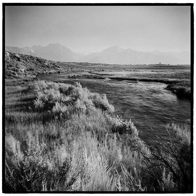 Smokey summer days in the Eastern Sierras. Hot Creek, Long Valley Caldera, California. * * * * * * * * * * * @mypubliclands @usinterior #mypubliclands #keepitpublic #protectourpubliclands #findyourpark #usinterior #protectthewild #aperturefoundation #lensculture #blackandwhite #holga #filmisnotdead #mediumformat #filmphotographic #documentary #mytinyatlas #afar #thegreatoutdoors #wildernessculture #americanwest  #california