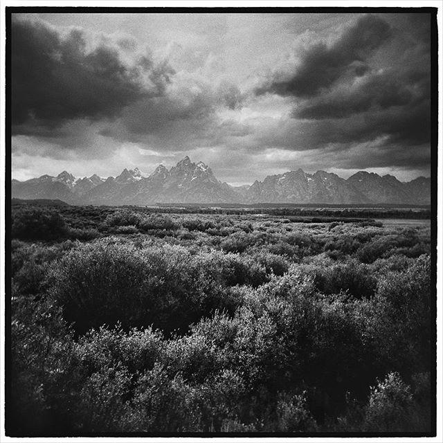 The iconic skyline of the Tetons. Jackson Hole, Grand Teton National Park, Wyoming. * * * * * * * * @mypubliclands @usinterior #mypubliclands #keepitpublic #protectourpubliclands #findyourpark #usinterior #protectthewild #aperturefoundation #lensculture #blackandwhite #holga #filmisnotdead #mediumformat #filmphotographic #documentary #mytinyatlas #afar #thegreatoutdoors #wildernessculture #americanwest