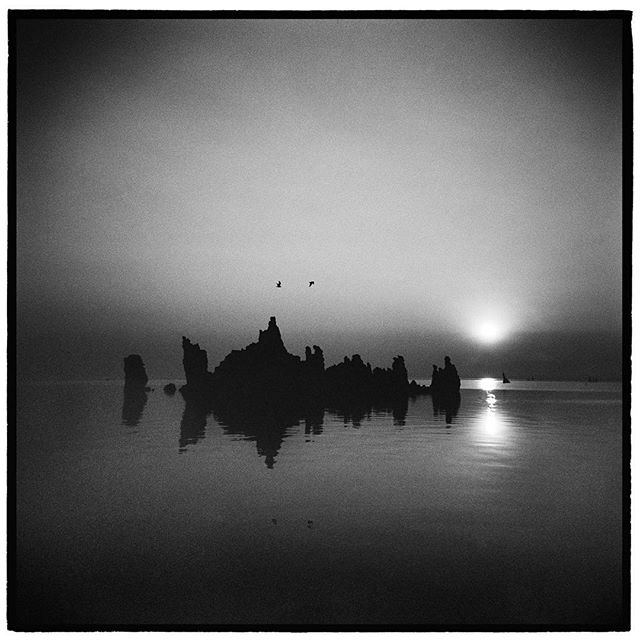 A thick blanket of smoke obscures the summer sun.  Tufa Formations, Mono Lake, California. * * * * * * * * * * * * @mypubliclands @usinterior #mypubliclands #keepitpublic #protectourpubliclands #findyourpark #usinterior #protectthewild #aperturefoundation #lensculture #blackandwhite #holga #filmisnotdead #mediumformat #filmphotographic #documentary #visitcalifornia #afar #thegreatoutdoors #wildernessculture #americanwest