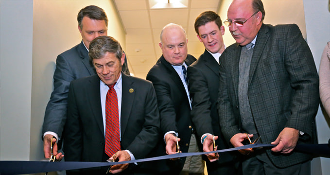 Jr. Chamber President Dan Wiegmann (second from right) helps cut during the Ribbon Ceremony for the new Science & Medical Arts Thiel College Study Annex at the Greenville Neuromodulation Center