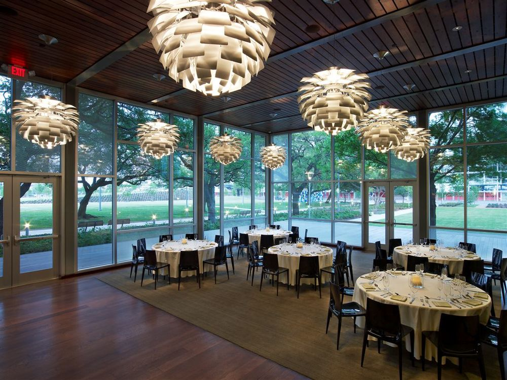 "PRIMAVERA ROOM Surrounded by Brazilian IPE wood and featuring a series of designer lamps, the Primavera Room is located at the end of the main floor. The Primavera Room includes a spacious private deck that has a breathtaking view of the natural gardens of Discovery Green Park, this includes the shaded walkway featuring 100 yr old oak trees, the butterfly garden, the Maconda's Grove and the 10,000 sq ft Grace Event Lawn.    Room Capacity:  Seated Dinner: 30 to 60 people; rounds of 10 each (60"") Stand Up Cocktail Reception: 60/80 people indoors, up to 120 people indoor/outdoor"