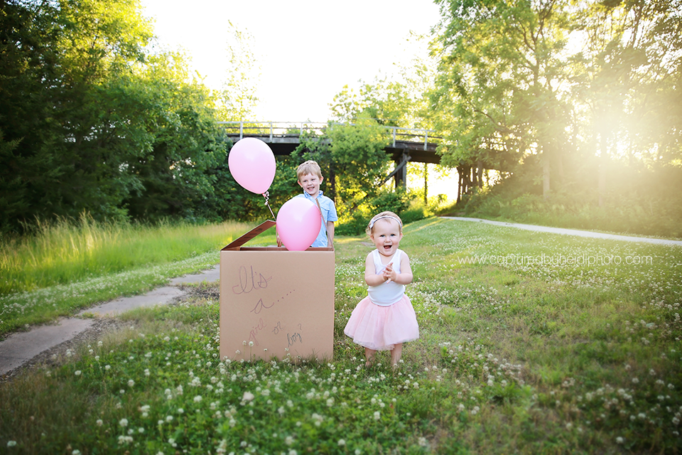 3-central-iowa-baby-children-family-photographer-cbh-photography-captured-by-heidi-gender-reveal-pink-balloons-brother-sister-plain-cardboard-box-sunset-pink-blue-rusty-heidi-hicks.png