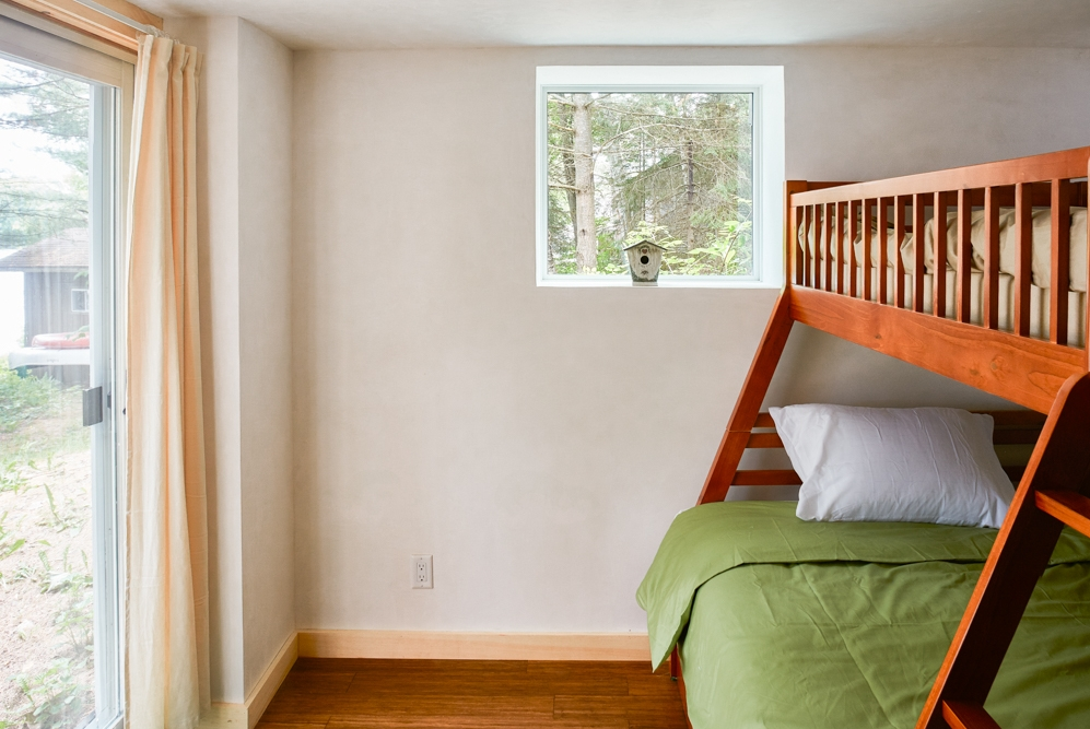 Bedroom, bunkbeds, plater walls, glass sliding door, wooden floor