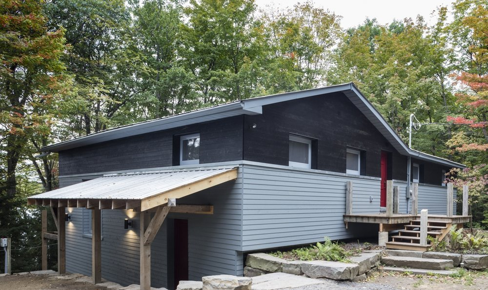 house with black and light blue wood siding