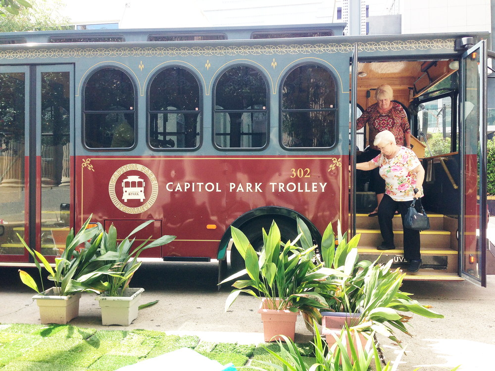 Riders are met by a PARK(ing) Day installation outside a stop on the Capitol Park Trolley route.