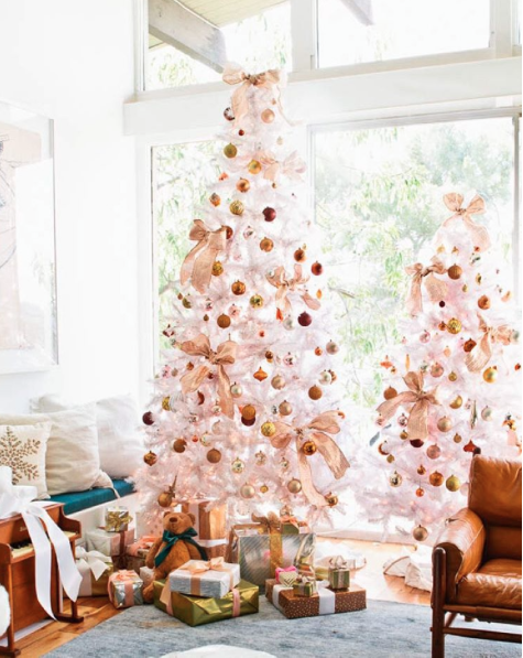 The cutest, Em Hendersons tree last year...love that white and metallic vibe.  That 70s vintage chair doesn't hurt either.
