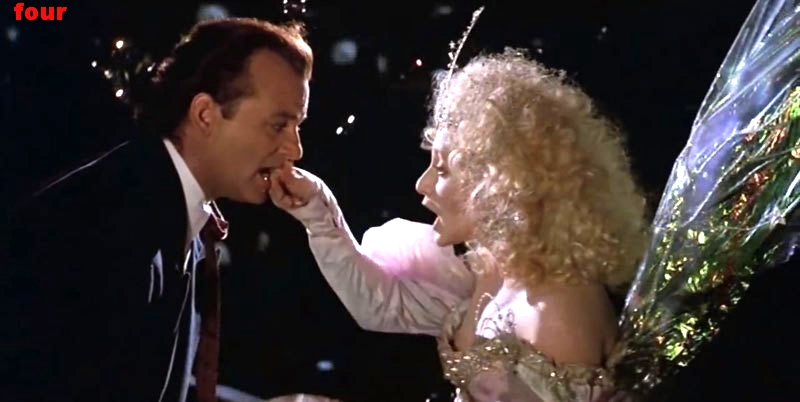 scrooged-ghost-of-christmas-present-grabbing-bill-murrays-lip.jpg