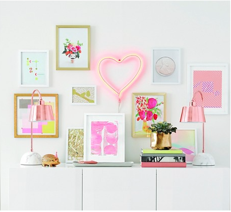 Oh Oh Joy...you had us at neon hearts and bright gallery walls with brass accents!