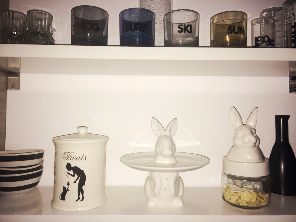 A poor lit shelfie taken at 5am in our rental that showcases our love of all things bunny.  Cake stand and jar both from IMM living.