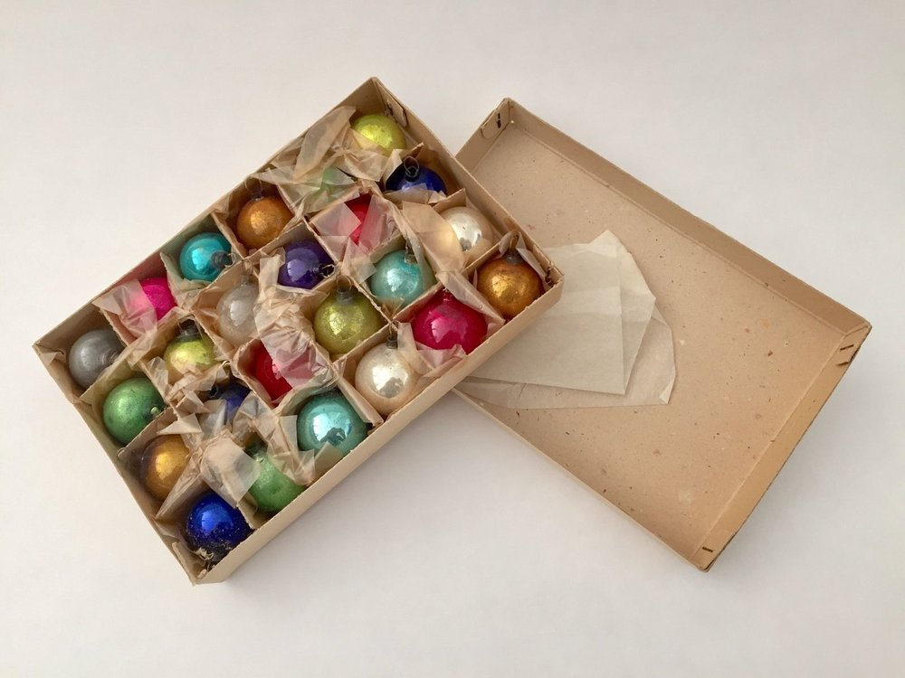 Vintage box of mercury glass ornaments.
