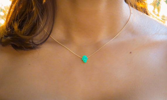Glow in a tiny Opal Hamsa from Minilali -