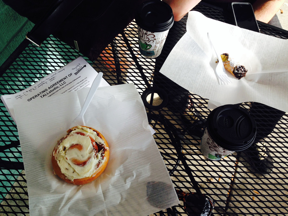 Reading over those pesky documents is always easier with a late afternoon cinnamon roll and cannoli.  Thanks French Kiss Pastries!