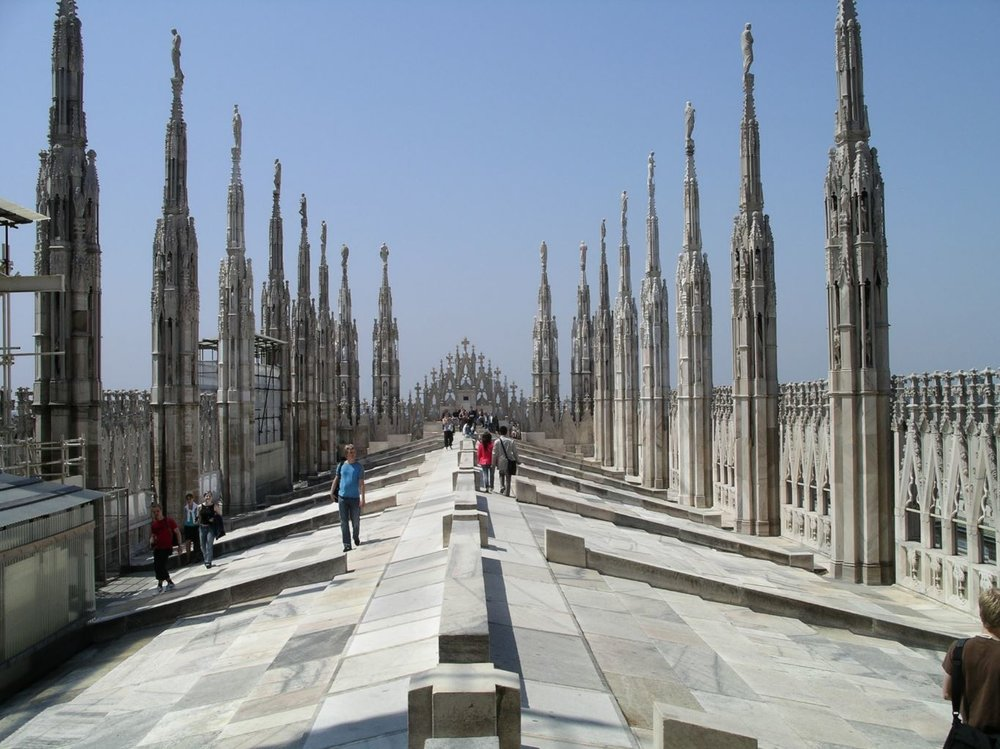 Roof of Milan Duoma - After reading your request, my mind returned to one of my favorite spaces; in part because of its specialty in its city. Every time I've returned to Milan I must walk up to its Duomo's roof top. It's a room, albeit with no ceiling and a sloped floor. The opportunity to walk through and among flying buttresses, to gaze out over a city that maps the history of architecture, to gaze at eye level into medieval statues, to ponder about the lives of people meandering in the piazza below or eating pizza in a roof top restaurant, makes it memorable in both personal and civic ways. To describe the room would be as difficult as describing space — and as irrelevant.photo: memphite.com