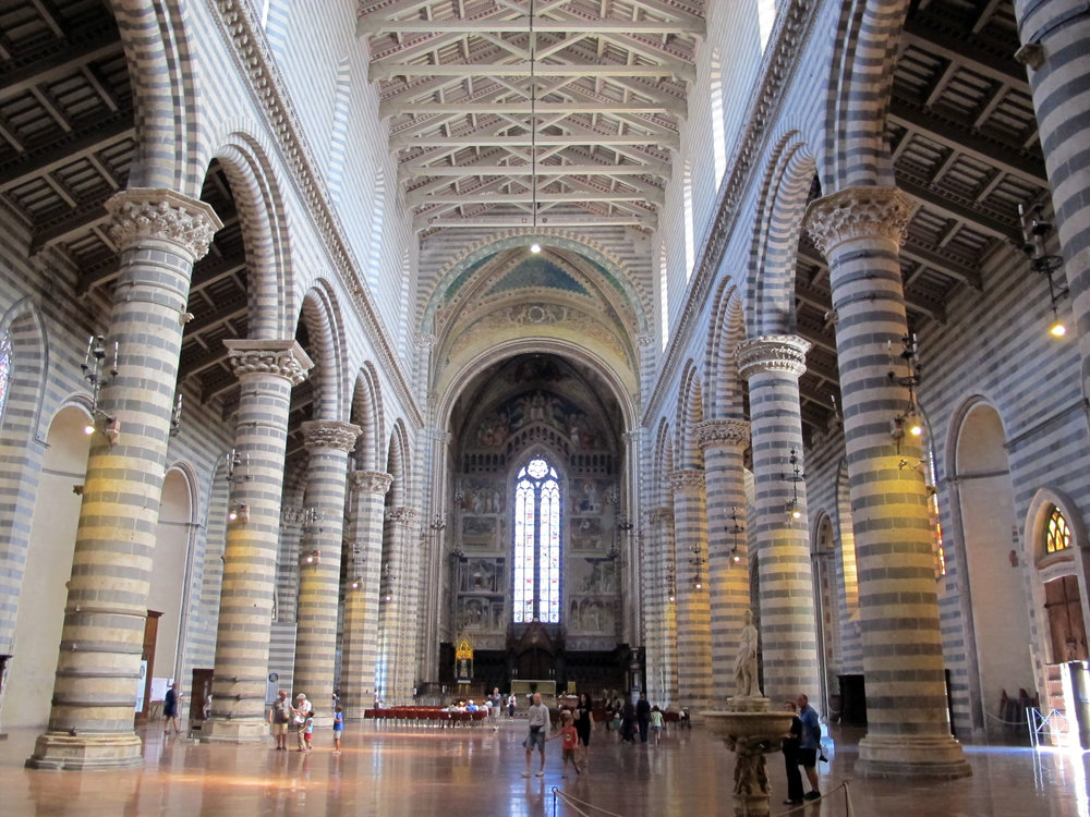 Duomo di Orviet, Orvieto, Italy - This 14th century Italian Gothic cathedral is probably my favorite cathedral. Its massive structure stands out atop the plateau on which the village was built upon. It's ornate front facade and striped sides make it unique. While the exterior is amazing to see, the interior is what takes your breath away. Literally. When I entered this cathedral I was completely overwhelmed by the magnitude of its sheer size and splendor. It is truly a spectacle to behold.photo: Wikimedia.com