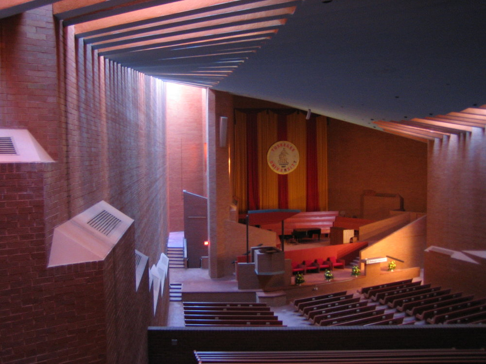 Tuskegee University Chapel, Tuskegee, Alabama - Transcendent. If you only had one word that explained what ecclesiastical architecture should be—that is it. It should evoke a moving presence, an expression, a hint, that God is near and will meet you at the altar. It should move men's hearts to action, it should compel them to look up and watch the sweet smoke of their burning prayer rising up to the Heavens. The Tuskegee Chapel does this—it's a place that defies logic. And even if you experience the space in person and aren't blown away, just wait 'til the choir starts singing and the organ starts playing. Ancient vibrations of sound of sound become light and we're lucky if we're not blinded.Architect, Paul Rudolphphoto: Jonathon