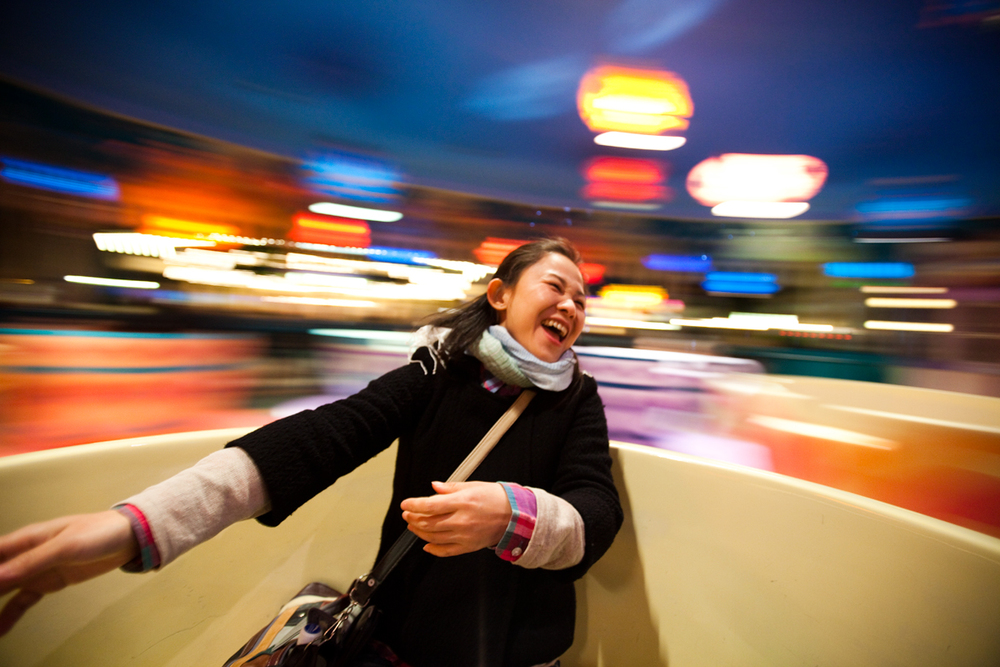 Fumi spinning in a cup at Disney Land