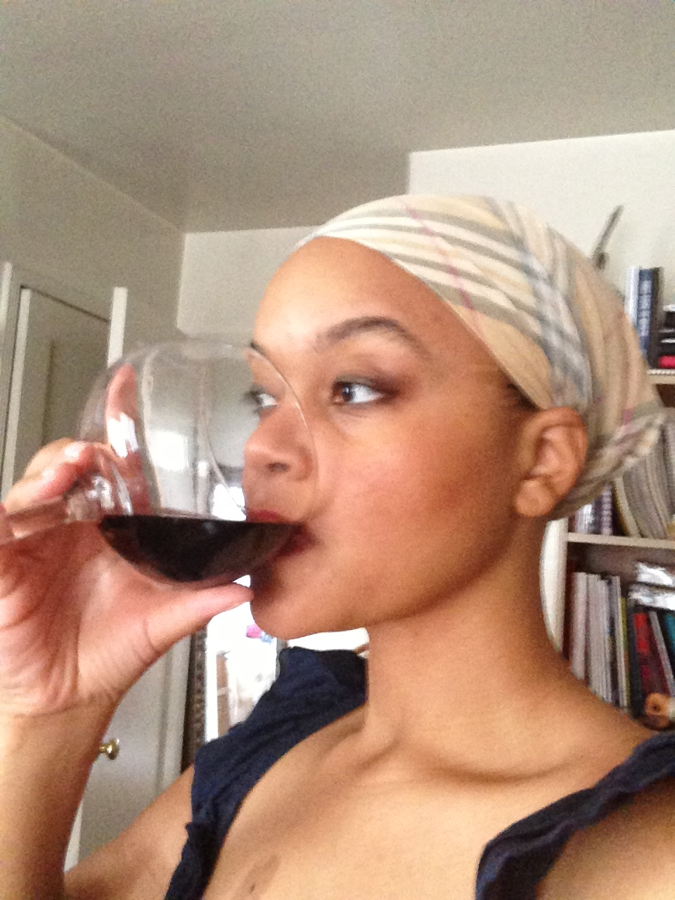Classy BlackGirl in Her Blogging Dress Drinking a Zin