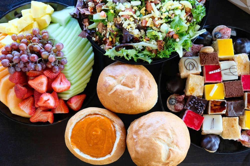 Catering - From platters of artisan sandwiches on specialty breads, trays of fresh fruit, bowls of salads, trays of our fresh Kouign Amann, to exquisite dessert platters—our catering and delivery service will make your next gathering or meeting delicious.