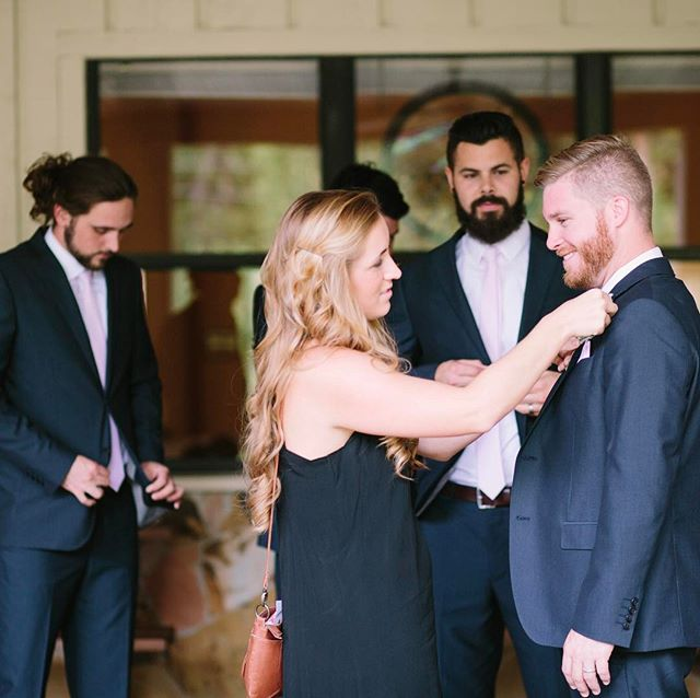 One of the few pictures I ever find myself in from a wedding (good thing—I like to blend in & be discrete) is pinning the boutonnière on the groom. Drew & Raquel's wedding was no exception.  #weddingcoordinator #leahmarieweddings #love