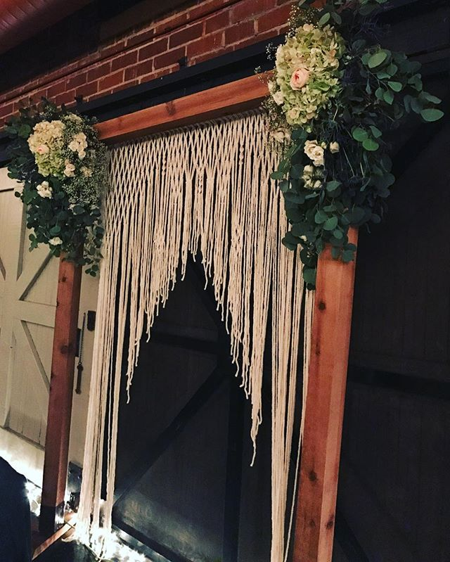 How dreamy is this macramé hanging from an arch built by the groom's best man and father and surrounded by @flowerno5's arrangement? It was used both for the ceremony and then transitioned as a backdrop for the sweetheart table during the reception!