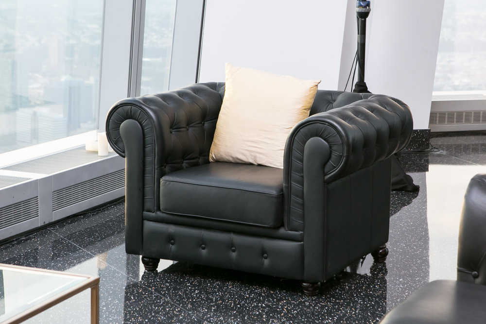 BLACK CHESTERFIELD ARMCHAIR