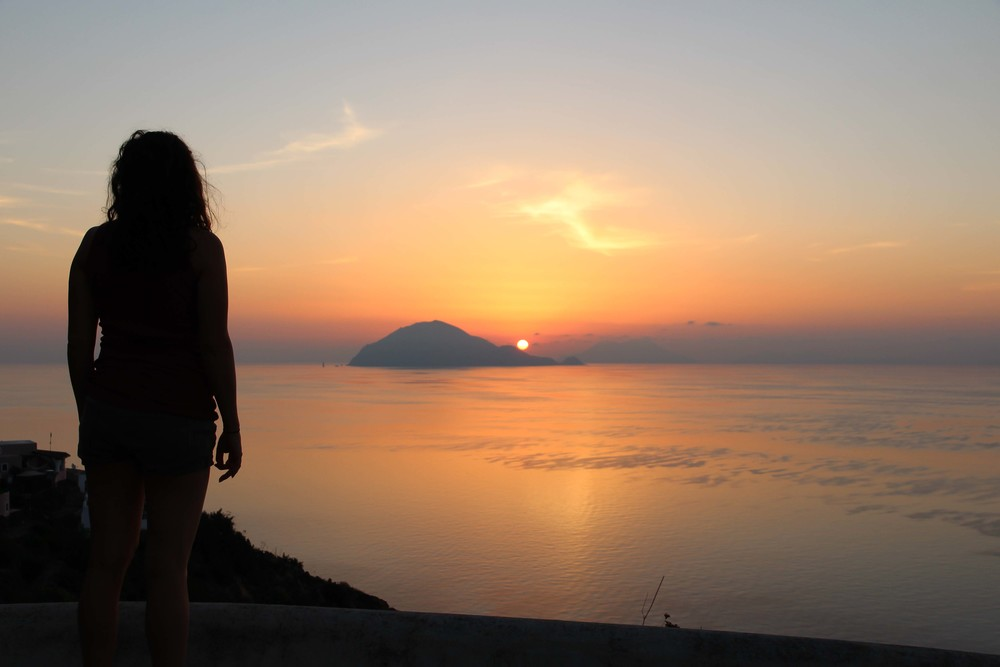 Lana and the sunrise over Filicudi