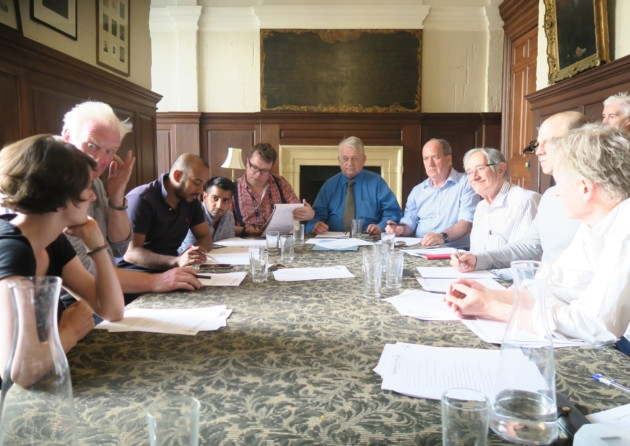 The members of the 2015-2016 Forum Council meeting in the parish vestry.