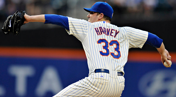 The New York Times    Harvey's Promise Confirmed in Debut  On Friday at Citi Field, Harvey showed he is a work in progress for the Mets, who lost, 4-0, to the Atlanta Braves, with Paul Maholm pitching a three-hit shutout and the Mets again falling five games under .500. Of course, his his father envisioned Harvey's future a lot earlier than any Mets fans had. A photograph of him at age 2 hangs on the refrigerator in his family's home in Groton, Conn. He is sitting on his knees beside a ball field, a baseball cradled in his palm, staring into the outfield.