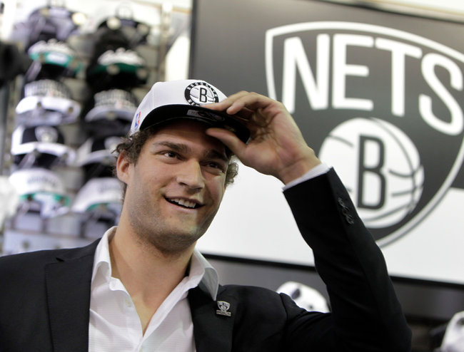 The New York Times    Lopez and Nets Are Happy, for Now  Ten hours after the Knicks cut ties with Jeremy Lin on Tuesday night, the Nets on Wednesday held a nice-that-you're-still-around news conference for the 7-footer Brook Lopez, who has signed a four-year, $60.8 million deal with the team.