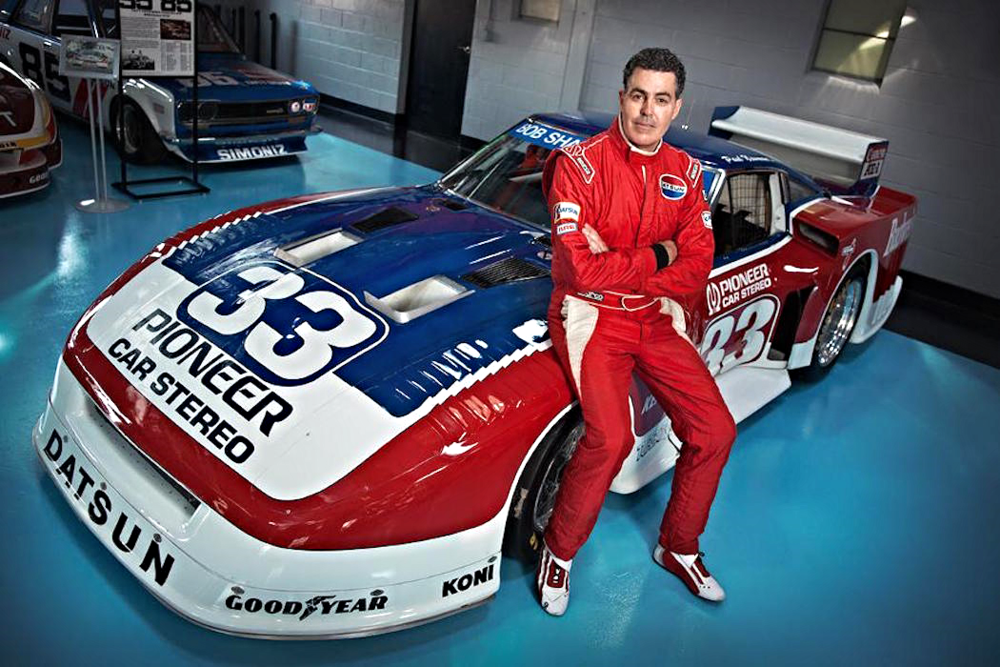 "Forbes   How Adam Carolla Became the Greatest Paul Newman Racecar Collector  A comedian, actor, filmmaker, bestselling author and pioneer podcaster, Carolla is above all an expert handyman. Before breaking into Hollywood, he spent 12 years in construction. Now he spends 12 hours a week on air, venting about everything from government handouts to specious ""service"" dogs on airplanes to proper pizza toppings. By his nature, he approaches everything with an I-can-do-it-better-myself attitude. It drives his most passionate pursuit: finding and restoring Paul Newman's race cars. To date, he has spent nearly $1 million acquiring and will spend another $1 million rebuilding seven of Newman's race cars–the largest known collection in the world."