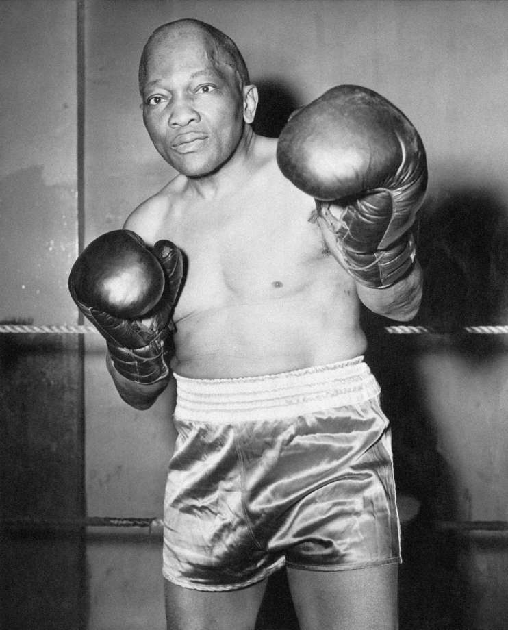 The Houston Chronicle   Jack Johnson: champion boxer defies racial strife  Persecuted, exiled, nearly assassinated and damned by a world determined to squelch his rebellious rise, Jack Johnson became boxing's first black champion but spent his life battling bigotry.
