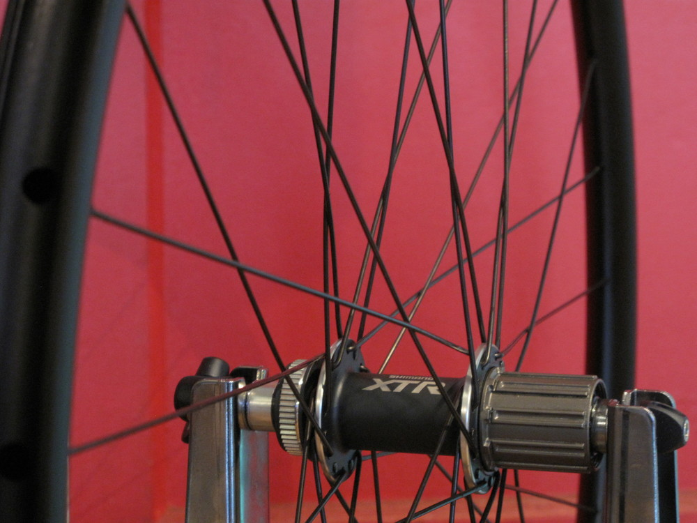 A smooth XTR hub and stiff, light HED Belgian rim make this one killer cross wheel.