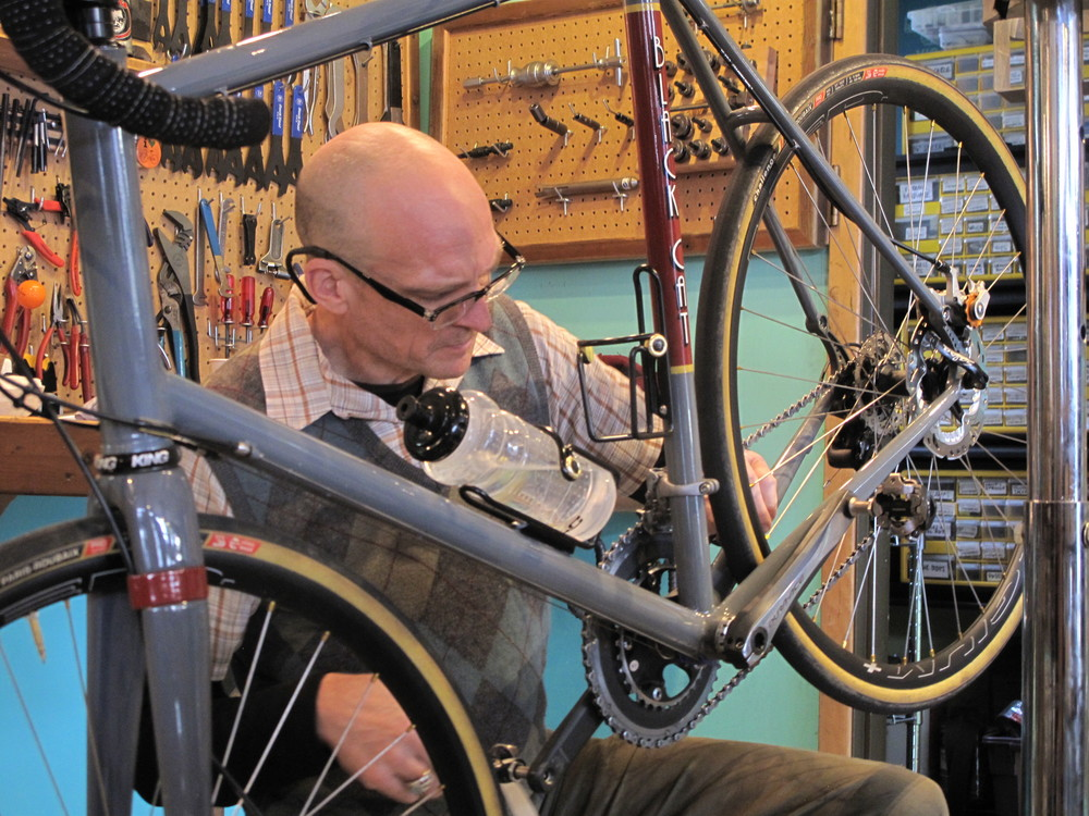 Kirk putting the finishing touches on a full-custom Black Cat with Dura-Ace components.