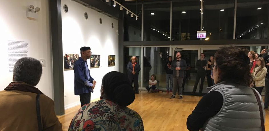 Philip Mallory Jones speaks to audiences at the opening of Dateline:Bronzeville at Dorchester Art and Housing Collaborative on September 30, 2016