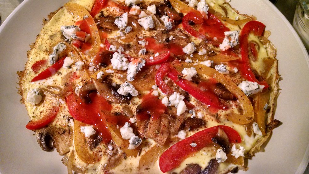 A simple, yet very tasty frittata made of red and yellow peppers, mushrooms, vidalia onions, one egg and crumbled blue cheese. Add Frank's Red Hot Sauce to taste.