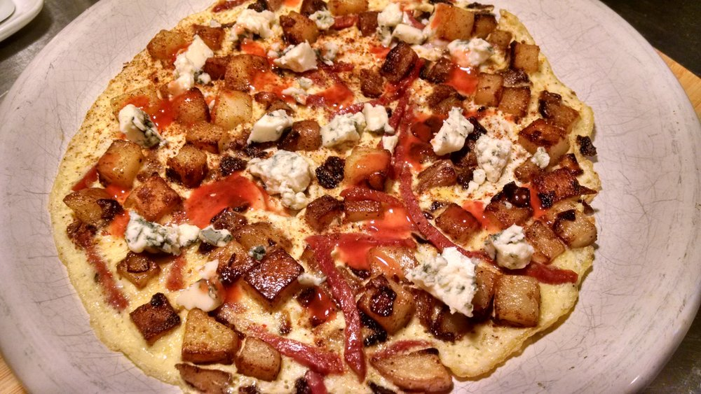 Another simple one, home fries, onions and matchstick soppressata (that's soppressata sliced into thin disks and then sliced super thin into, yes, matchsticks) with more blue cheese crumbled on top. Do I detect a pattern?