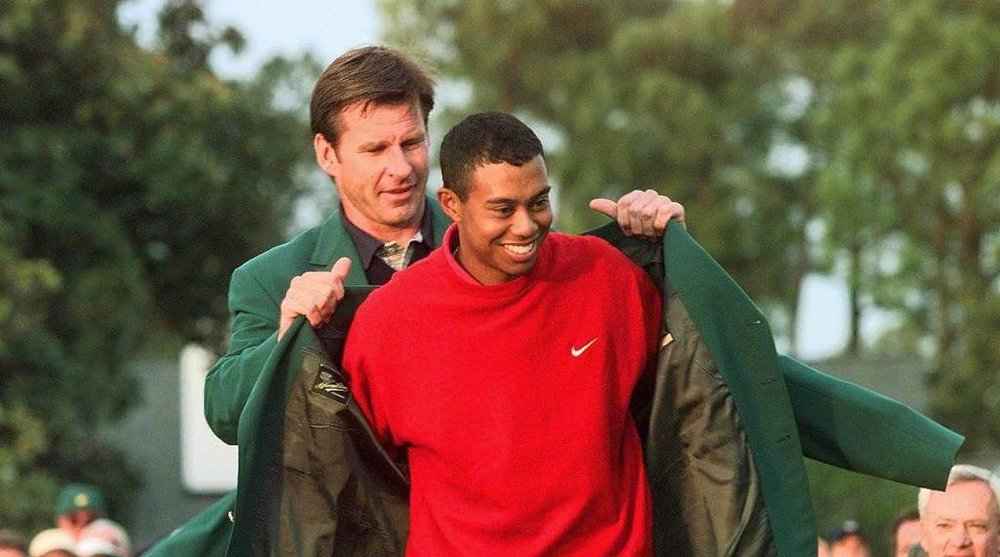 Tiger receiving his Green Jacket from 1996 champion Nick Faldo