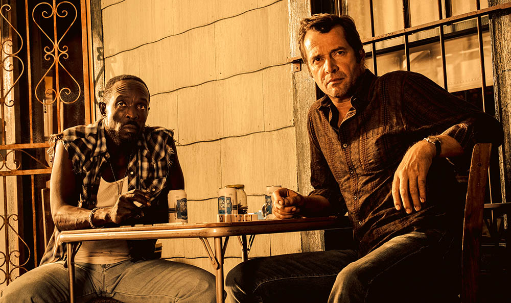 Michael Kenneth Williams as Leonard Pine and James Purefoy as Hap Collins