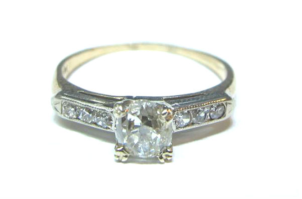 Art Deco .56ct Old Mine cut diamond engagement ring with six single cut diamonds on the shoulders, in 14K yellow and white gold, at Gray & Davis