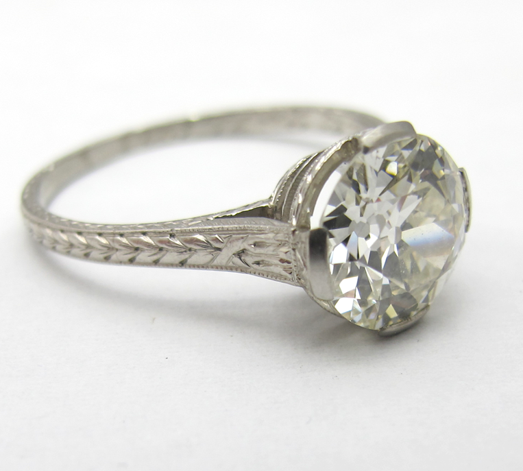 GIA certified 2.10ct L color, VS2 clarity old European cut diamond in hand-engraved platinum setting. Art Deco, c.1920s.