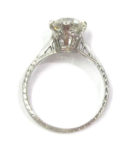 Platinum ring w/engraved detailing and 1.63 carat J color, VS2 clarity old European cut diamond. Art Deco, c. 1924.