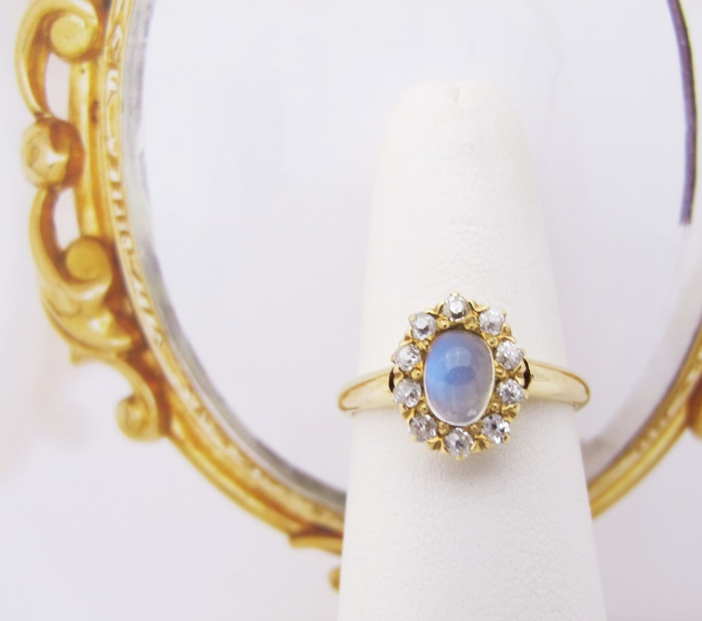 14k gold, moonstone and diamonds. Circa early 20th century.
