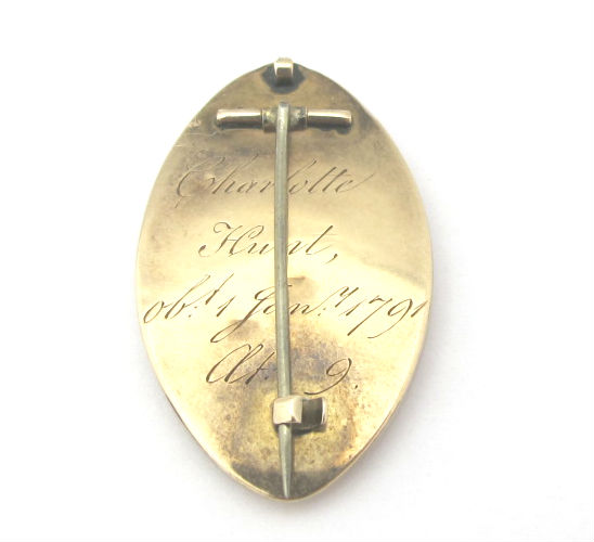 "The back of the mourning brooch, which reads ""Charlotte Hunt, ob. Jan 7 1791"""