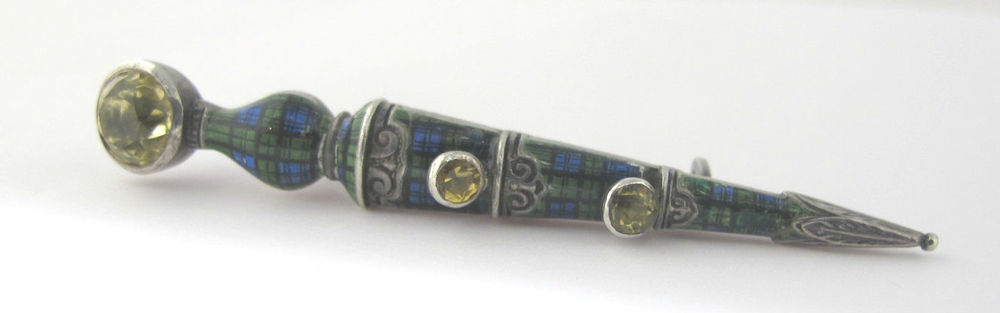 Victorian sterling silver pin with citrine, enamel and yellow pasts. Available at Gray & Davis.