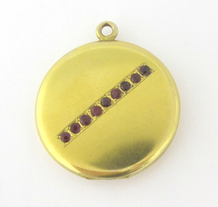 Vintage 14k gold locket, in our  online shop .