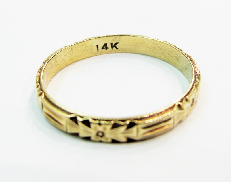 "Vintage yellow gold wedding band with a typical ""14k"" stamp to indicate its gold content."