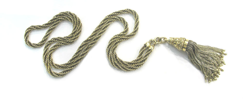 "Mid-19th century 14k gold tassel with floral, hand engraved detail. Featured on a 14k gold 25"" rope chain. Both available at Gray & Davis.."
