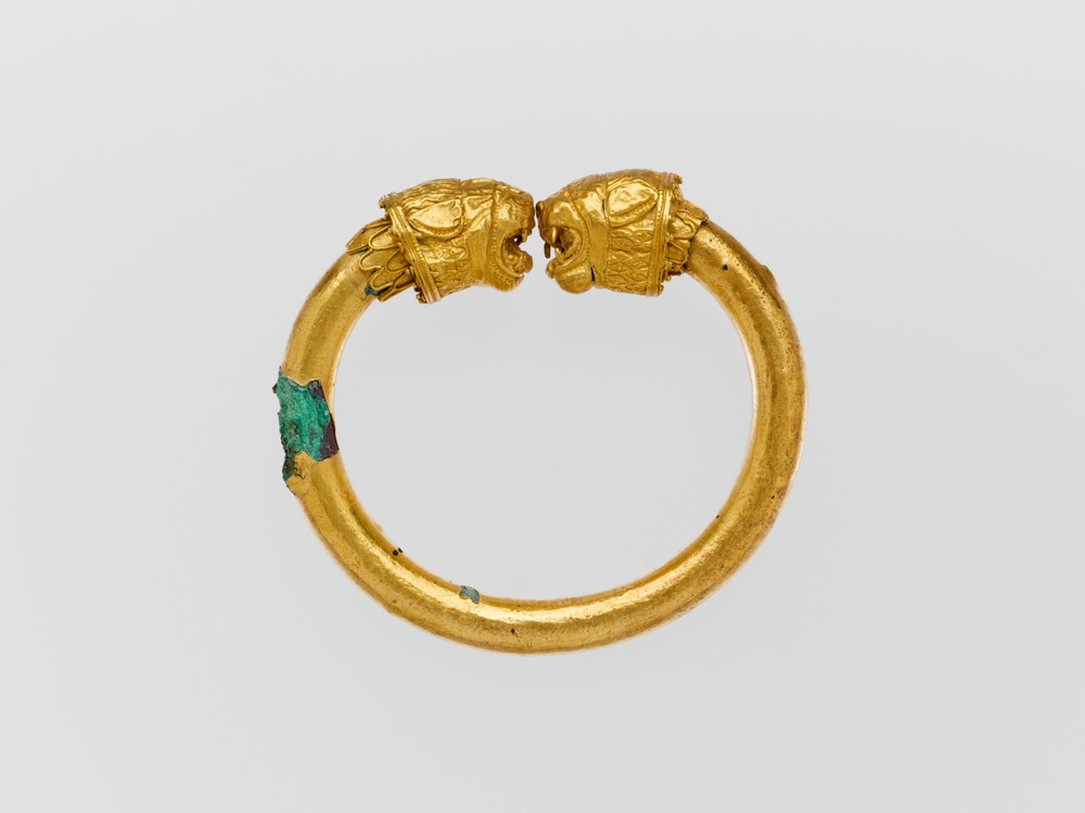 Gold & Copper Alloy Bracelet w/ Lion-Head Finials. Cypriot, 5th Century BC. Metropolitan Museum of Art, 74.51.3559.