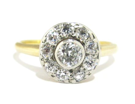 14k yellow gold and platinum ring with 0.98 carats of old European cut G-I color and VS/SI1 clarity diamonds.