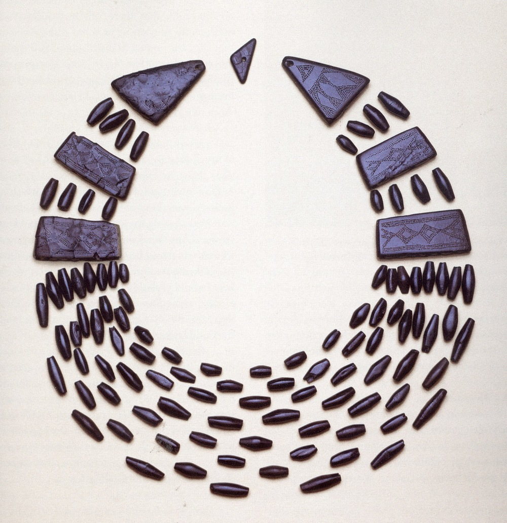 Whitby jet beads found at a burial in Killy Kiaran, Scotland. c. 2050 - 1800 BCE. National Museums, Scotland.